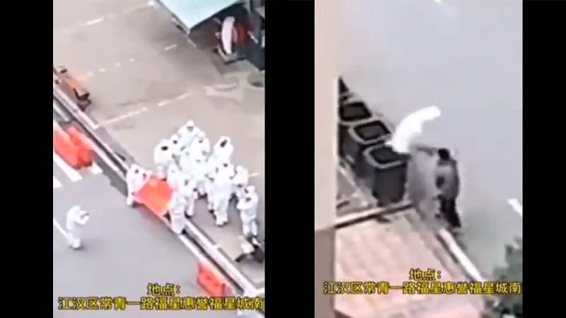 武汉党官集体摆拍邀功 拍完脱下防护服就扔(视频)