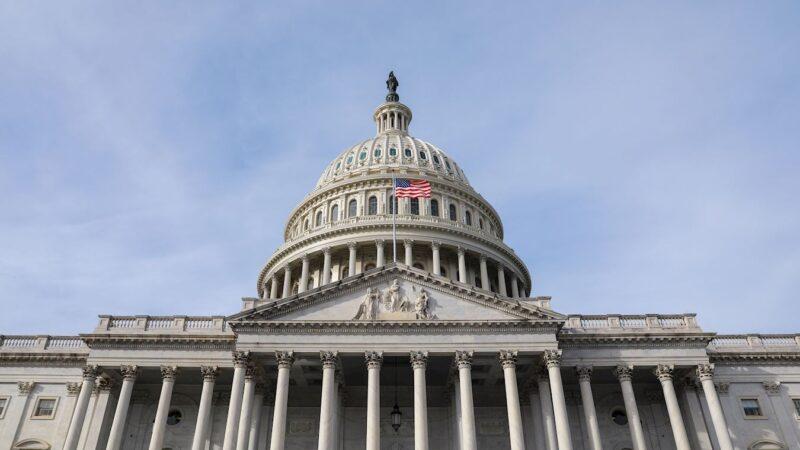 从美国国会大厦为庆祝法轮大法日悬挂国旗说起