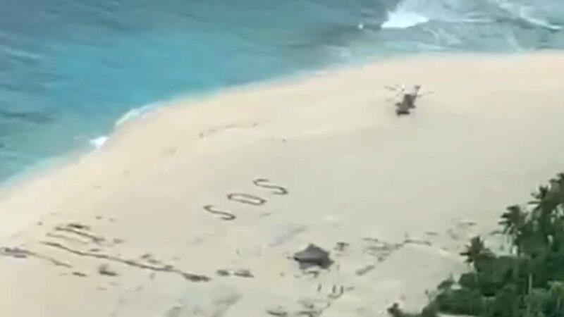 3男受困无人岛与世隔绝3天 海滩上写SOS获救