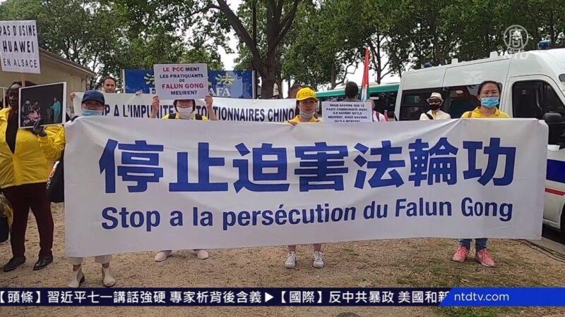 巴黎七一街頭酷刑展 路人支持法輪功