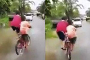 两男孩共骑一辆自行车 自由穿行让人赞