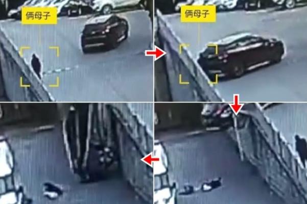 重庆女倒车把母子撞下斜坡 母护子躲过劫难