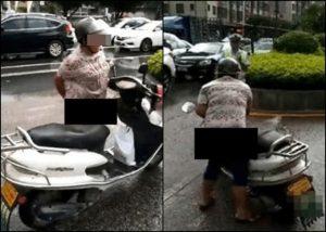 為阻攔交警扣車 廣東婦「排泄物」抹車身