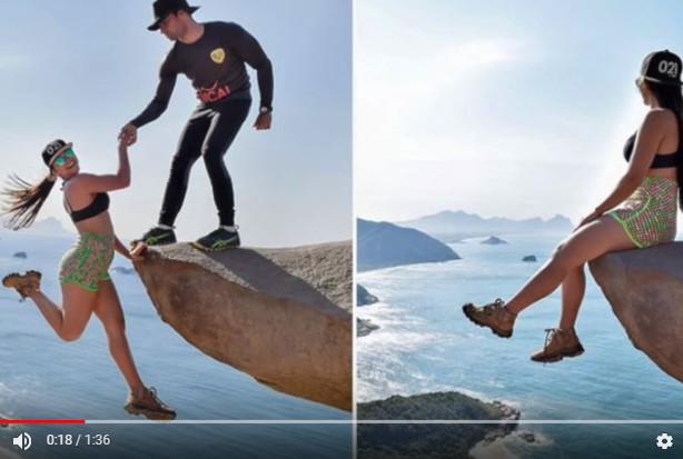 情侣挂在悬崖边拍照 镜头一拉远 大家都笑了(视频)