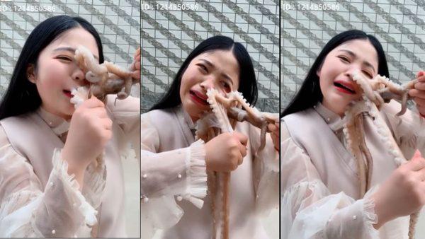 """陆网红表演生吞章鱼 反被章鱼""""生吞""""(视频)"""