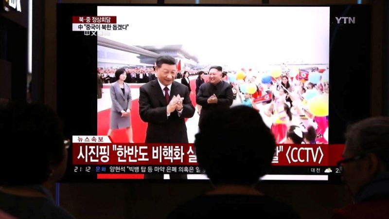 习近平与朝鲜高层合照 金与正未现身引起关注