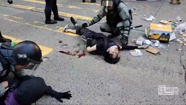 港警今早连开3枪伤2人 防暴警枪指民众多区抓捕
