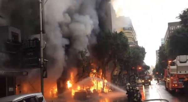 疑雨衣客纵火 北市林森北路大楼火警酿4伤疏散500人