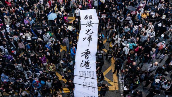 香港國際人權日大遊行 80萬人潮逼爆街頭(組圖)