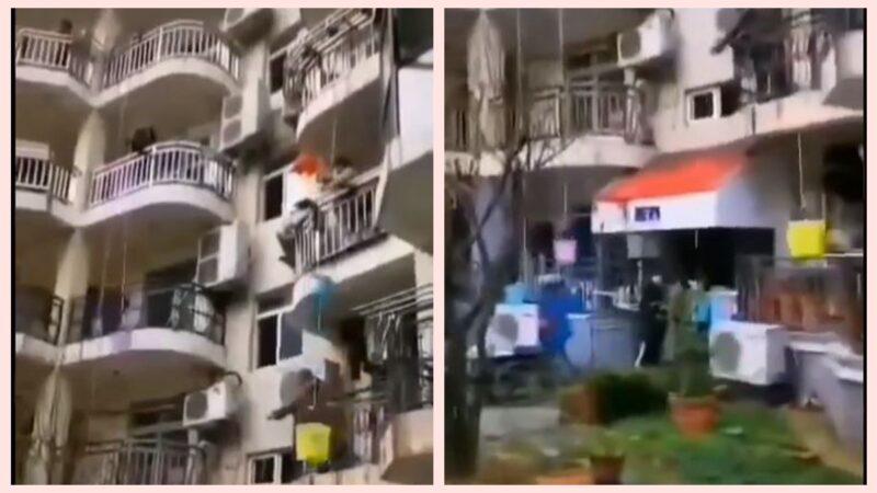 """中国疫区""""封楼"""" 居民无奈用水桶吊食物(视频)"""