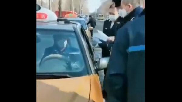 哈爾濱男染疫開出租 警察嚇得直後退(視頻)
