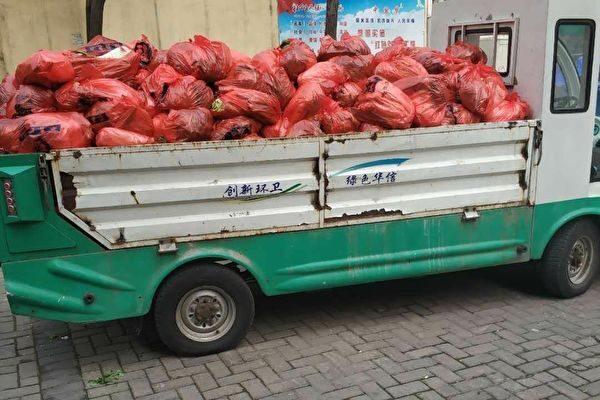 袁斌:武汉官员用垃圾车给居民运肉是工作失误?