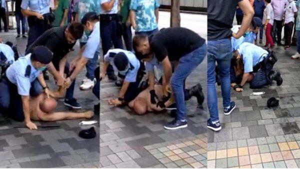 """香港男遭警察压颈亡 警称""""适当武力"""""""