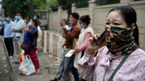 全民检测50万人已感染 武汉女斥政府脑残(视频)
