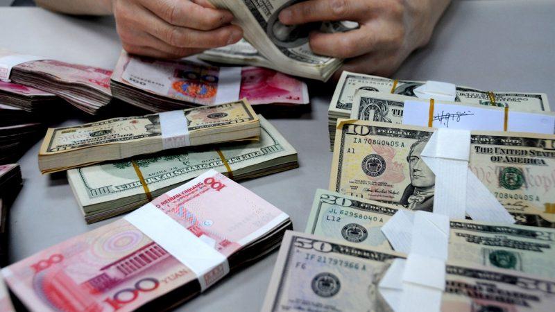 人民幣兌美元全線跌破7.1