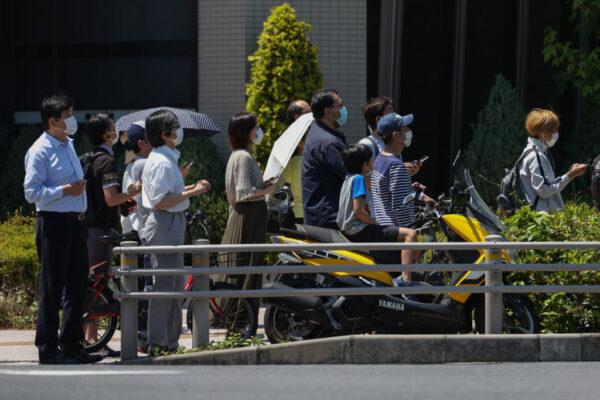 日本全面解禁 东京景点现人潮 配戴口罩比率增