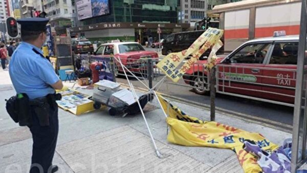 香港法輪功真相點遭襲擊 市民大聲遏止歹徒