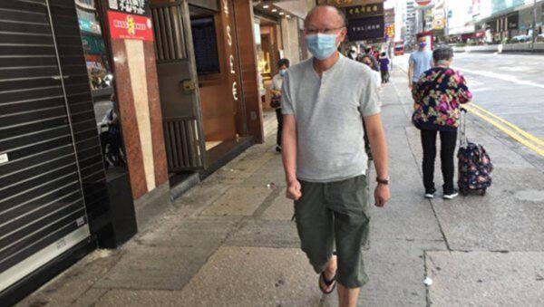 香港法輪功真相點遭襲 光頭男搶手機打人