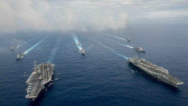 中共28架軍機擾台 美航母戰鬥群南海演練