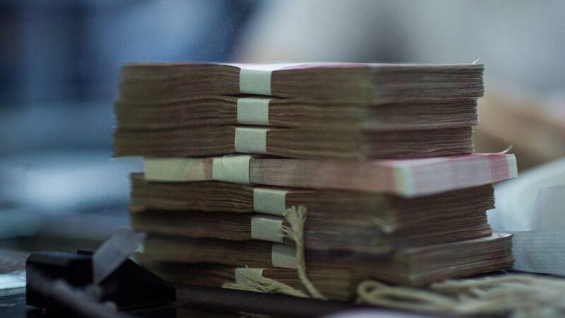 中国两金融高管同日被查 印钞公司原老总贺林落马