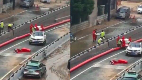 郑州市京广路隧道在7月20日遭遇洪灾后,抬出死者遗体。(视频截图/新唐人合成)