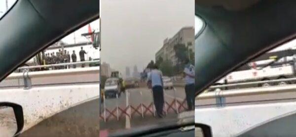 郑州市京广路隧道在7月20日遭遇洪灾后,隧道被警察封锁,现场还有武警。(视频截图/新唐人合成)