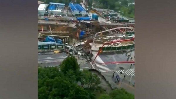 洪水過後鄭州數百處路面坍塌 多棟樓房傾斜(多視頻)