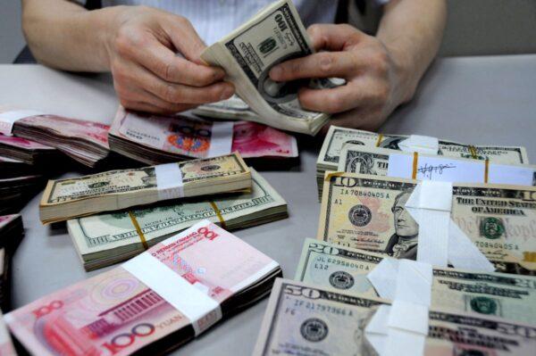 人民币汇率跌至6.5关口 创逾三周新低